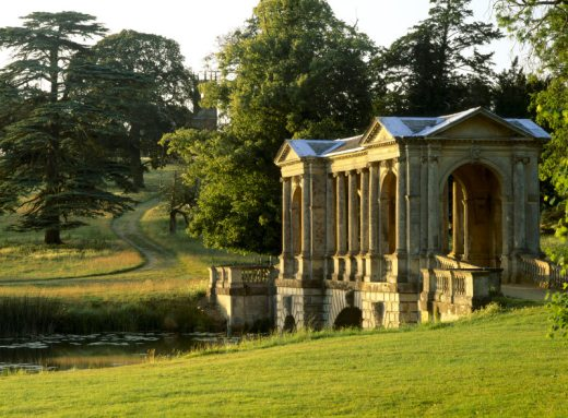 A view of the Palladian Bridge with the Gothic Temple visible through the trees, taken in the late afternoon. The bridge was probably built by James Gibbs, and completed in 1738.